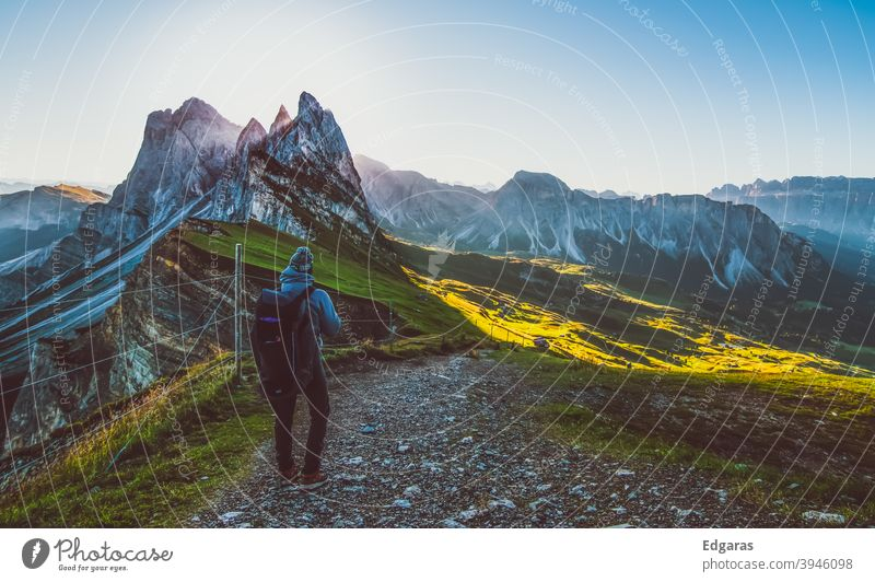 A hiker man hiking in Seceda, Dolomites, Italy dolomiti Hike Hiking Hiker Mountain mountains trekking travel outdoor view scenic landscape tourist freedom