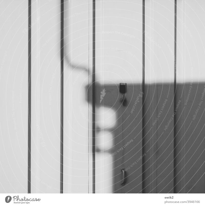 basic data Garage Shadow Garage door Gray White Black & white photo lines Tin door handle Deserted Exterior shot Goal Day Wall (building)