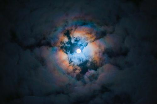 Full moon behind clouds Aura December wreath of light Moon Rauhnacht Full  moon Clouds Dark somber Night at night Sky Light Long exposure Night sky