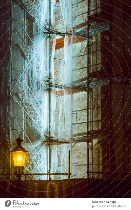 lighted scaffolding at church Scaffold Construction site Church neon tube Stairs Winter Illuminated Scaffolding Lantern Night at night Facade Deserted Building