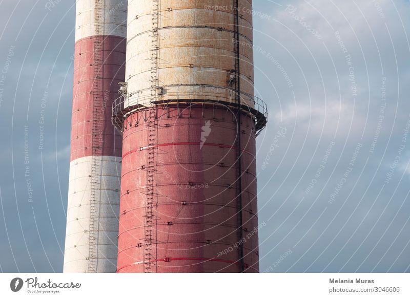Close-up of old brick industrial chimneys by coal mine. Architecture, abstract industrial background. Global warming, CO2 emission, coal energy issues. Coal