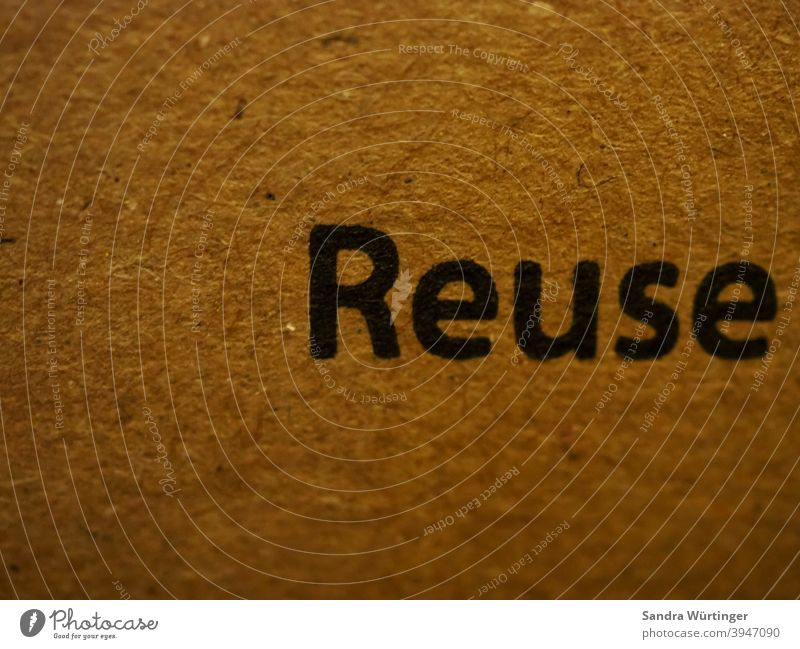 """Cardboard box with the inscription """"Reuse"""" / call for reuse sustainability Recycling Environmental protection Packaging recycle Reusable Ecological Trash"""
