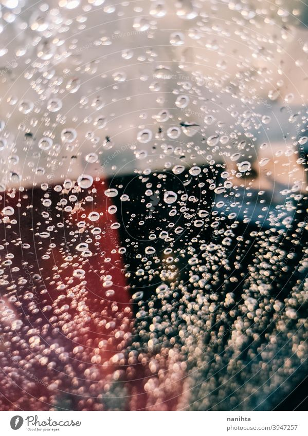 Vibrant background of water drops in a shower abstract texture bokeh depht of field lights contrast vibrant cool clean dark backdrop wallpaper intense no people