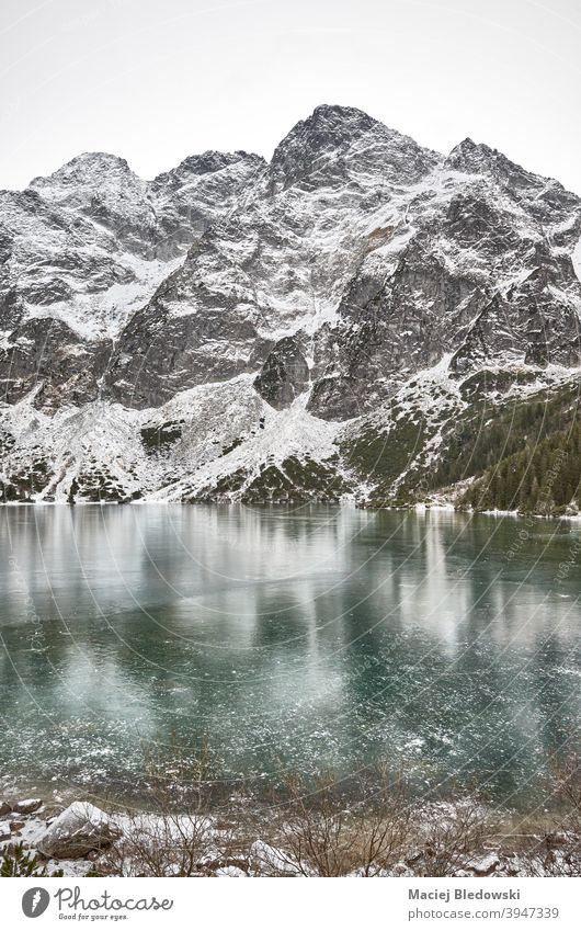Frozen lake on a snowy day in Tatra National Park, Poland. winter landscape mountains Morskie Oko Eye of the Sea ice beautiful Tatry cold wilderness sky outdoor