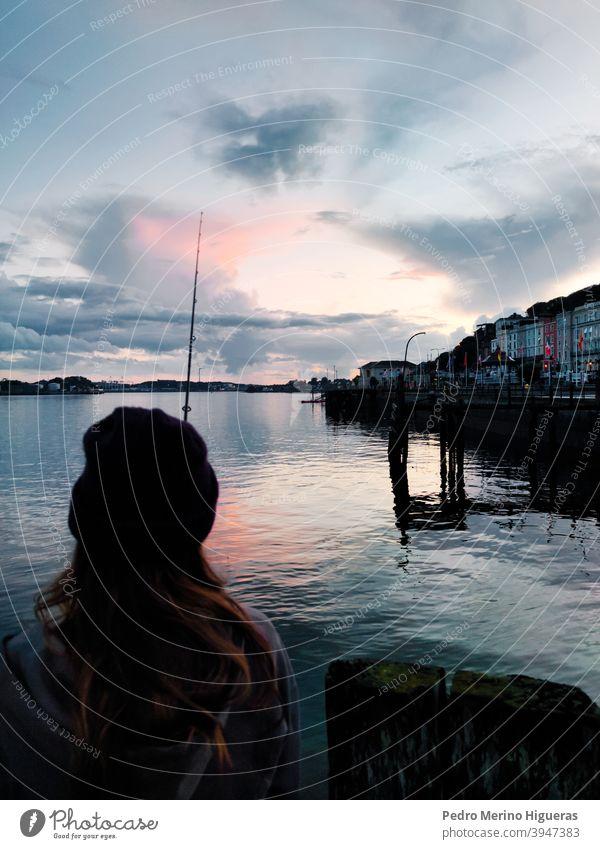 Girl fishing in Ireland Fishing bay sea water port girl girl fishing town reflections ireland beautiful landscape Coast Fishing village Bay