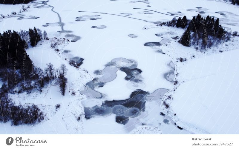 Aerial view with a drone of a frozen lake in Bavaria Aerial photograph drone photo Lake Body of water Frozen Ice Winter Snow Water circles Circle shape