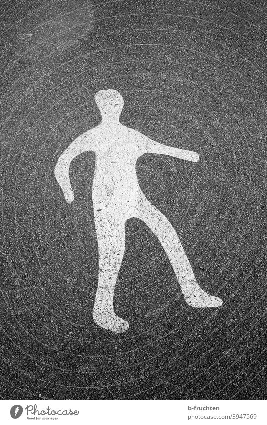 Figure painted on asphalt, road marking, person Sign Road sign Man White Street Asphalt Floor covering Ground Lanes & trails Going gender Human being Clue point
