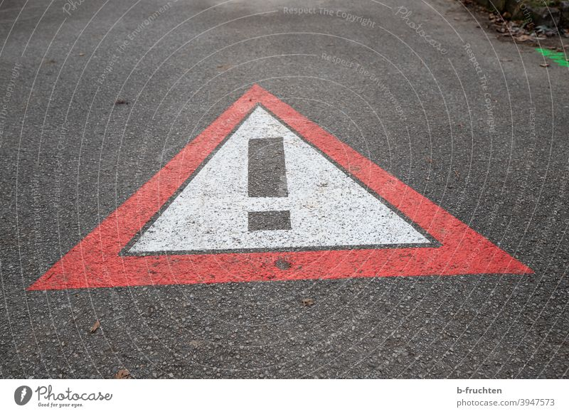 Traffic sign painted on the road, danger sign, danger spot Caution Road sign Sign symbol call sign Street Asphalt peril Painting (action, artwork) off