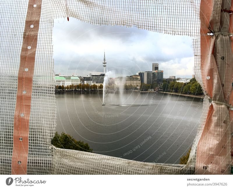 Falling out of the frame. Hamburg Vantage point fountain Alster Lake Town Skyline Television tower Clouds Construction site Peephole Panorama (View)