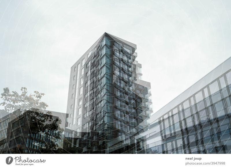 Double exposure - architectural shot of a skyscraper Architecture Facade Glass Brick Modern dwell chill structure Monochrome Subdued colour Blue Gray Deserted