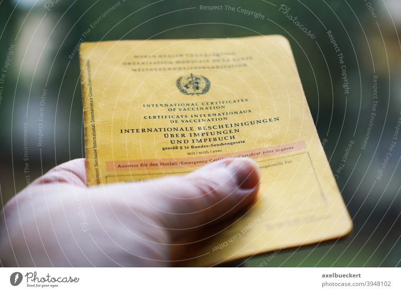 Hand holding International Certificates of Vaccination and Vaccination Booklet Vaccination book Vaccination certificate Immunization Healthy Illness medicine