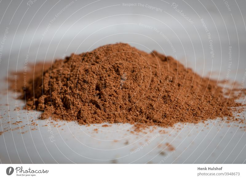 Ground nutmeg in a heap aroma aromatic background brown closeup cuisine culinary delicious dried dry flavor food healthy herb ingredient isolated macro muscat
