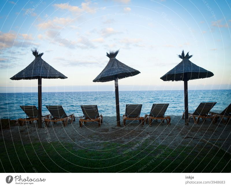 S E H N S U C H T lockdown Colour photo Ocean Horizon evening mood parasols Beach Lie Deserted Blue Beautiful weather holidays free time vacation Off-Season