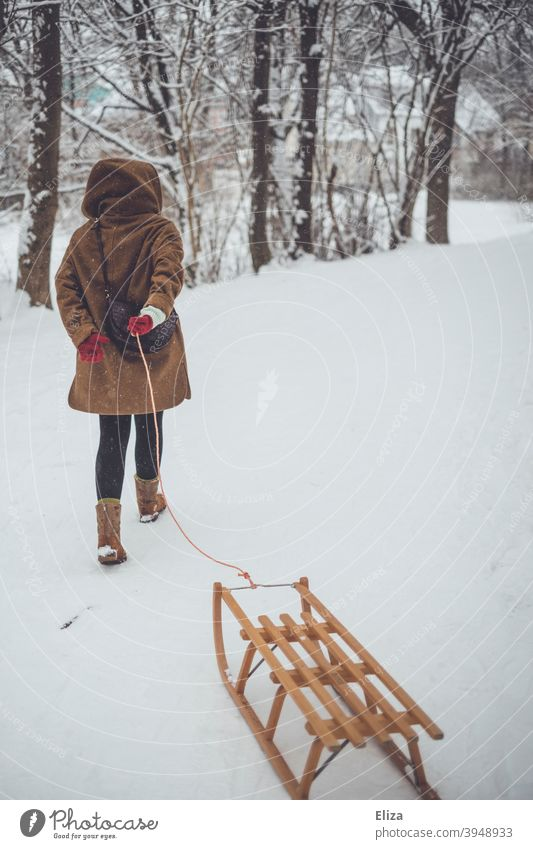 A woman pulls a sled through the snow. Winter atmosphere. Sleigh Pull Landscape wood sledges winter landscape Snow Winter mood Snowscape Woman Cold out Nature