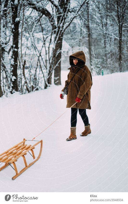 A woman with a sledge in the snow in winter Winter Snow Sleigh Woman Cold snowy Nature Forest Coat Brown Hooded (clothing) wood sledges Winter's day