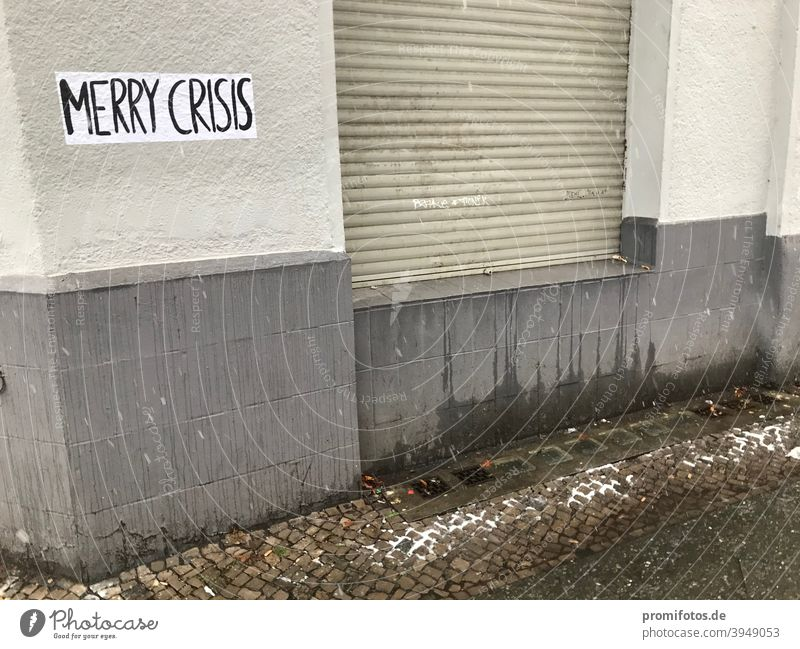 "Lettering ""Merry Crisis"" on a house wall. Photo: Alexander Hauk merry crisis climate crisis Financial Crisis banking crisis political crisis Climate finance"