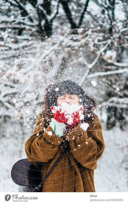 Woman blowing snow in winter Snow Winter Joy Snowscape snowy Nature out Cold White Winter mood Winter forest Winter's day Gloves Coat youthful frisky