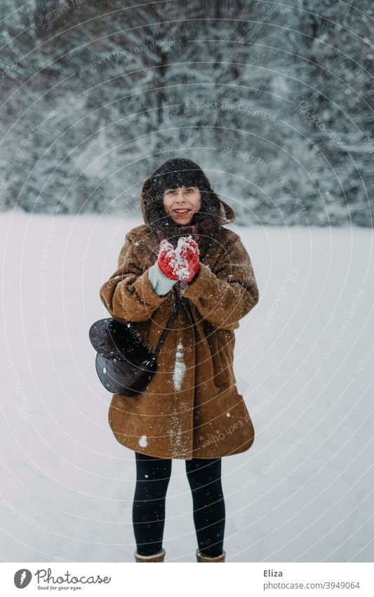 A woman in the snow Woman Snow Snowball Winter Funny Joy Dark-haired Human being White winter landscape Landscape out Nature Snowfall Winter's day Winter mood