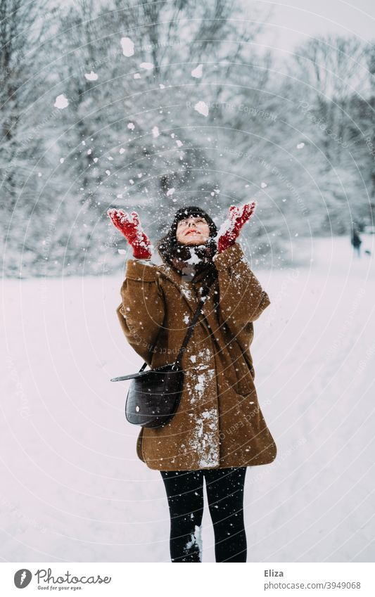 Woman throws snow in winter Snow Winter Throw Joy Snowscape snowy Nature out Cold White Winter mood Winter forest Winter's day Gloves Coat youthful