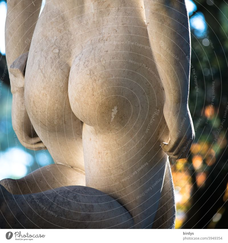 shapely buttocks of kneeling naked woman - statue made of stone. naked buttocks behind Bottom bastard Naked Feminine Statue Kneeling Rear view Eroticism