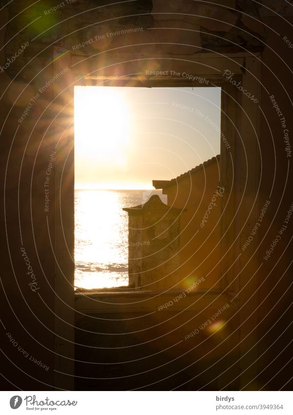 Sun over the sea shines through a window. Sunbeams Window Ocean Vantage point Horizon Light Mediterranean House (Residential Structure) Warmth house by the sea