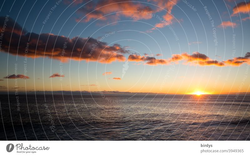 Sunset over the Atlantic Ocean. Evening atmosphere with scattered clouds, sunlight .sun on the horizont Sunrise Horizon sunset Sunlight Reflection calm sea