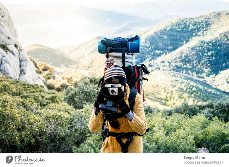 Girl hiker with backpack take a picture. Travel lifestyle concept. expedition woman camping adventure happy trekking explorer journey outdoor travel traveler