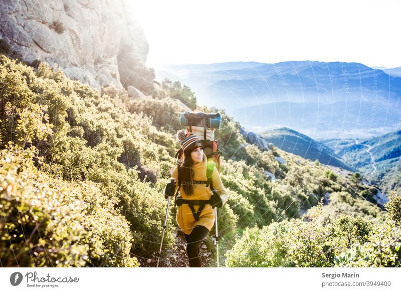 Happy hiking girl with a backpack ascends a mountain path. Travel lifestyle concept. expedition woman camping adventure happy trekking explorer journey outdoor