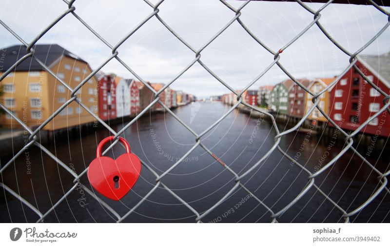 love lock, heart padlock on bridge fence in Trondheim river forever relationship couple honeymoon romance travel romantic city trip tradition trondheim