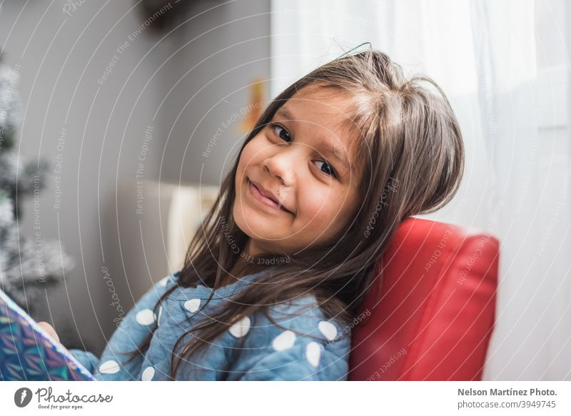 Shallow focus shot of a happy little girl with dark hair. Portrait Hispanic Child Girl childhood portrait kid cute beautiful Infancy young happiness smile