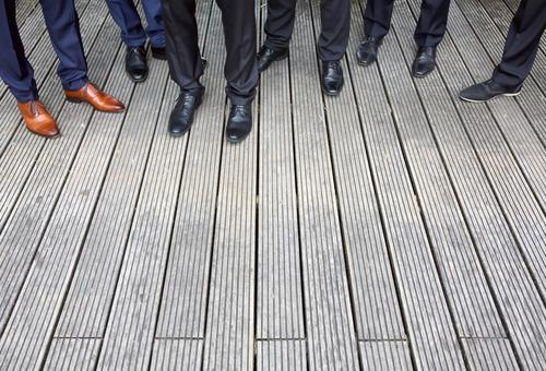Group photo with shoes Footwear Legs Feet Pants Clothing Stand Wait Fashion Floor covering wooden floor Terrace Suit trousers Chic Wedding party Friendship