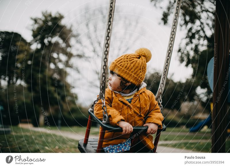Child playing in the playground Slide Playground Park having fun Playing Joy Infancy Exterior shot park childhood Leisure and hobbies Kindergarten Colour photo