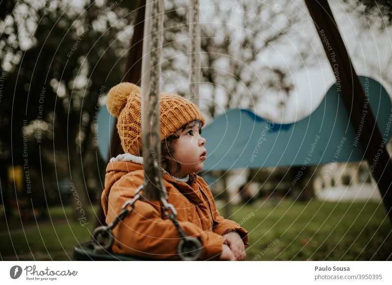 Child playing on playground Slide Playground childhood Girl 1 - 3 years Happy Joy Day Human being Colour photo Infancy Exterior shot Playing Kindergarten
