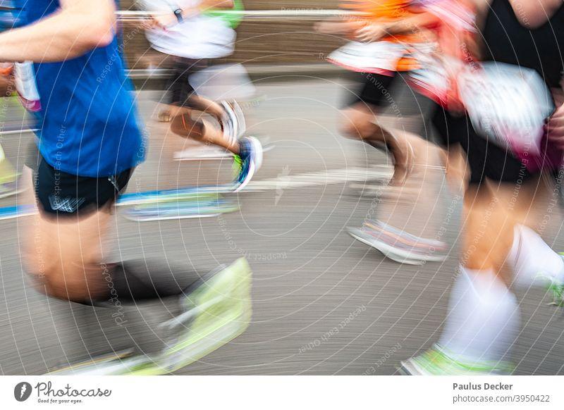 blurred marathon runner on an asphalt road Marathon Runner jogging shoes Speed Endurance Jogging Running Jogger Movement Exterior shot competition Athletic