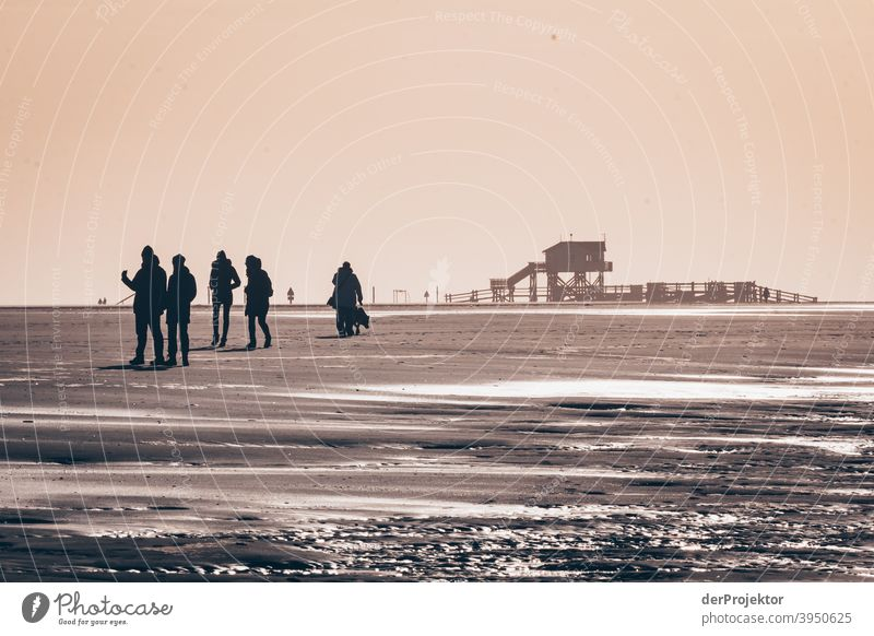 Noon in San Peter-Ording on the beach with poison stalls and people shadows XI Wide angle Panorama (View) Long shot Worm's-eye view Deep depth of field Sunrise
