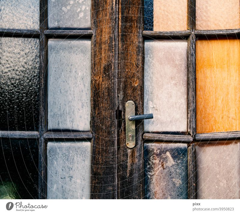 12 months time Wood door Closed door handle Front door Entrance Goal locked caginess rusty Diagonal slats Colour Redecorate Painting (action, work) daylight