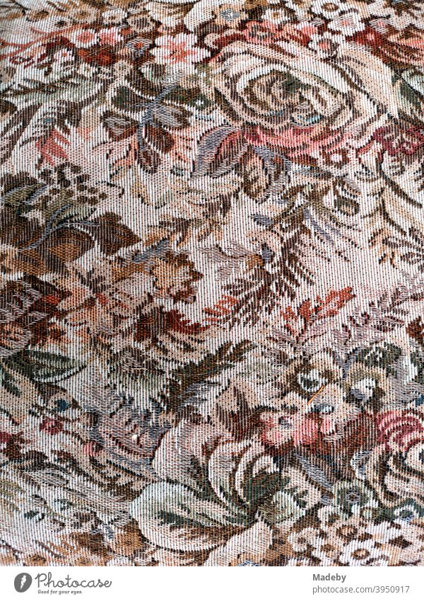 Fabric pattern with flowers, branches and plants of an old armchair in the bulky waste Furniture Cloth fabric cover Armchair Armchair cover Flowery pattern