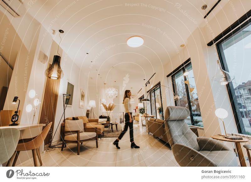 Young woman walking through livingroom home house interior female young indoors person comfortable pretty lifestyle floor caucasian inside modern furniture