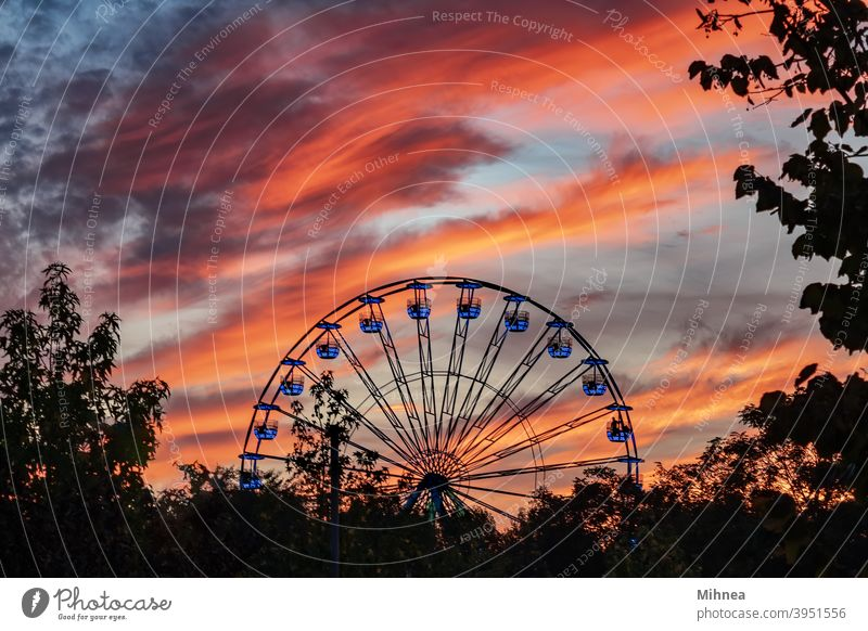 Ferris wheel at sunset in Tineretului Park, Bucharest pleasure Attraction Carnival Carousel Circle City Clouds dramatic sky Entertainment Evening Fair