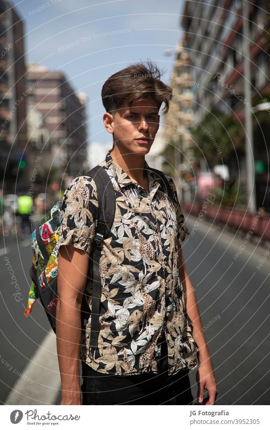 Portrait of authentic young man with skateboard in the middle of the street. portrait guy skateboarder urban model fashion retro attitude look gaze face poster