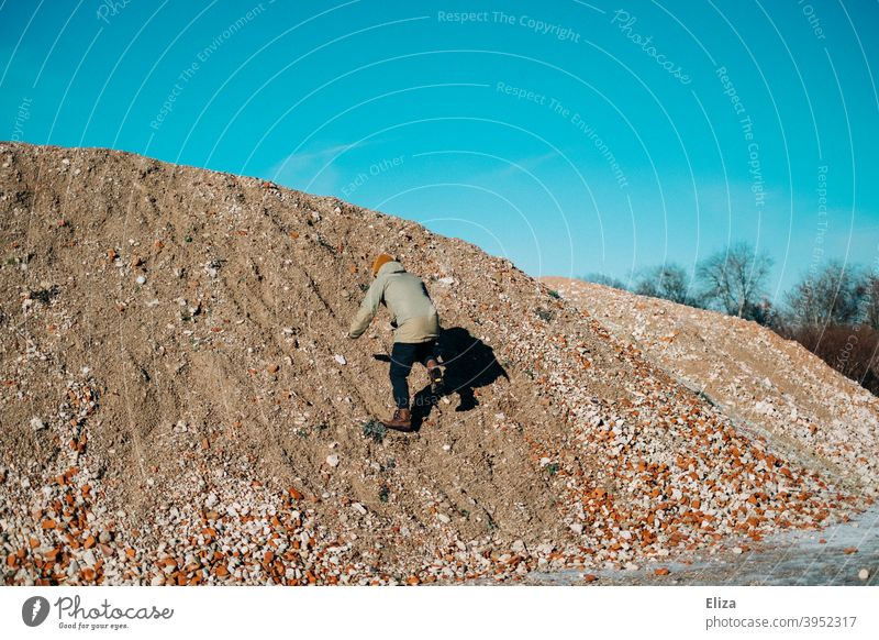 Now hurry... | Climb the hill! Hill Climbing Gravel Man climb mountain Tall Human being slippery Blue sky