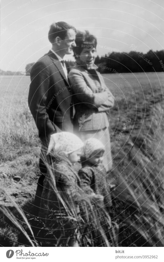 Contemporary history l young family in the field. Family & Relations youthful Young woman Young man Father Mother Parents Child Infancy children Daughter Sister