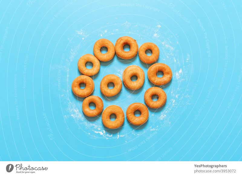 Donuts aligned in a circle shape. Homemade fresh doughnuts, top view american baked bakery blue background breakfast cake calories comfort food confectionery