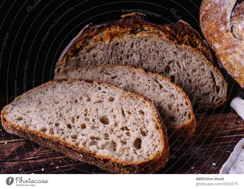 Slices of fresh bread on wooden table slice baked homemade sweet piece kitchen food delicious culinary nutrition cuisine tasty meal yummy breakfast bakery