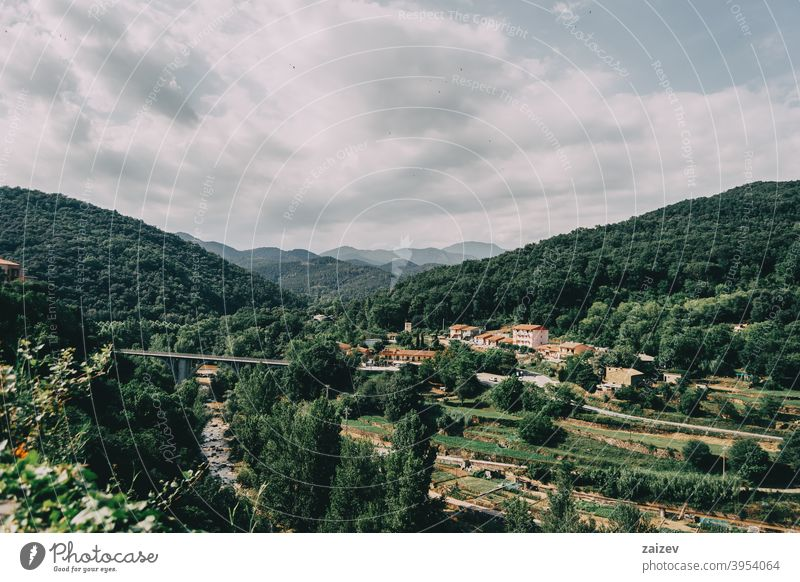 mountains of sadernes on a cloudy summer day in spain girona spain catalonia green nature wood beauty blue bright foliage road rock scenery scenic sky sunlight