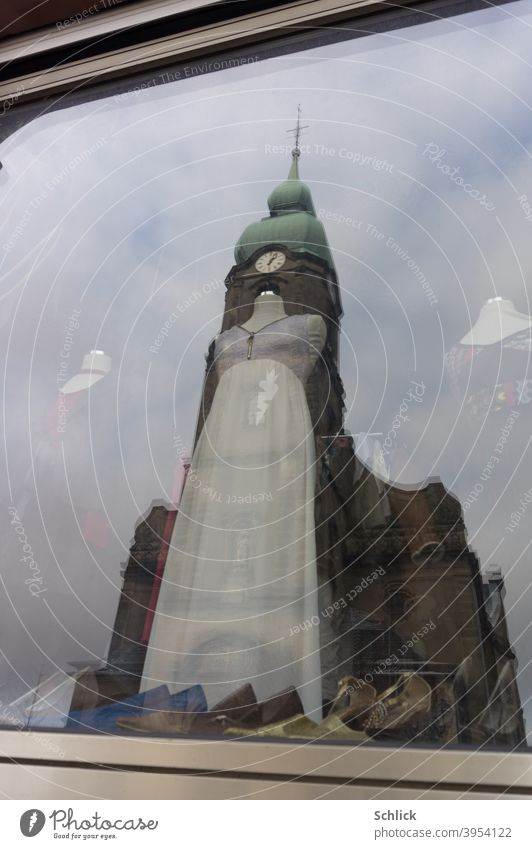 Church notre Dame de la chapelle in Freyming Merlebach Lorraine reflected in a shop window with headless mannequin Mannequin reflection Overlay Overlay effect