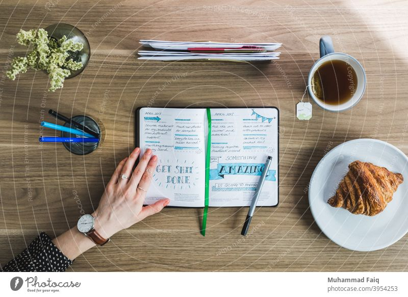 Morning Journal Photo workspace white mug copy space table journal hot drink fresh morning breakfast cup plan diary coffee wooden indoors Desk notebook Office