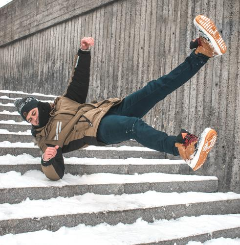 Man slip on ice and falling down stairs Slippery surface Slip and fall Slip on ice Falling down stairs Stairs Winter Ice Snow Risky Injury Dangerous Accident