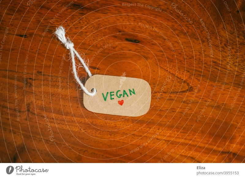 A label with the word vegan written on it. Vegan lifestyle. vegan lifestyle vegan products Shopping Consumption Products Label commodities cruelty-free veganism