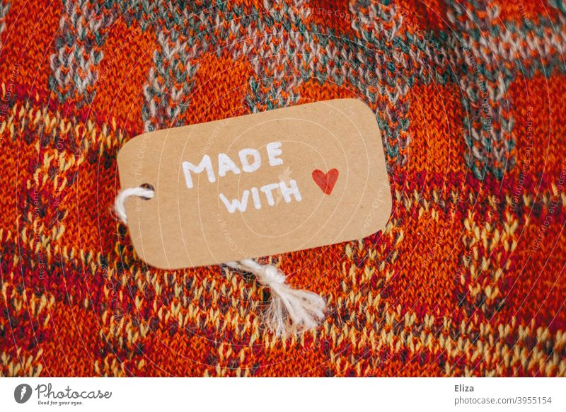 """A label with the words """"Made with Love"""" on a self-knitted garment Made with love crafted knitwear garments affectionately homespun shop locally Unique specimen"""